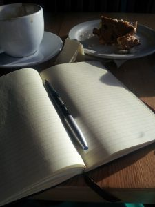 notebook open with cup of tea