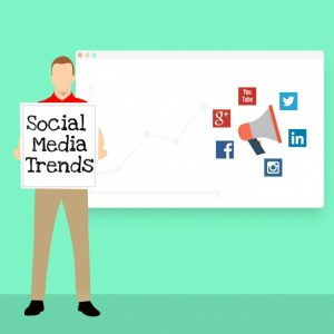 """clip art of man holding a sign titled """"social media trends"""" standing in front of a white board"""